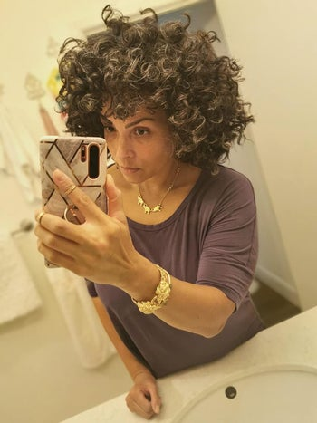 reviewer with graying 3b curls that look springy and hydrated