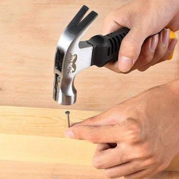hands using the small hammer