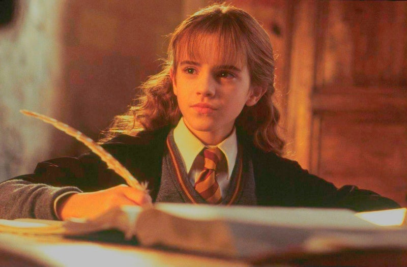 Hermione looks up from her writing