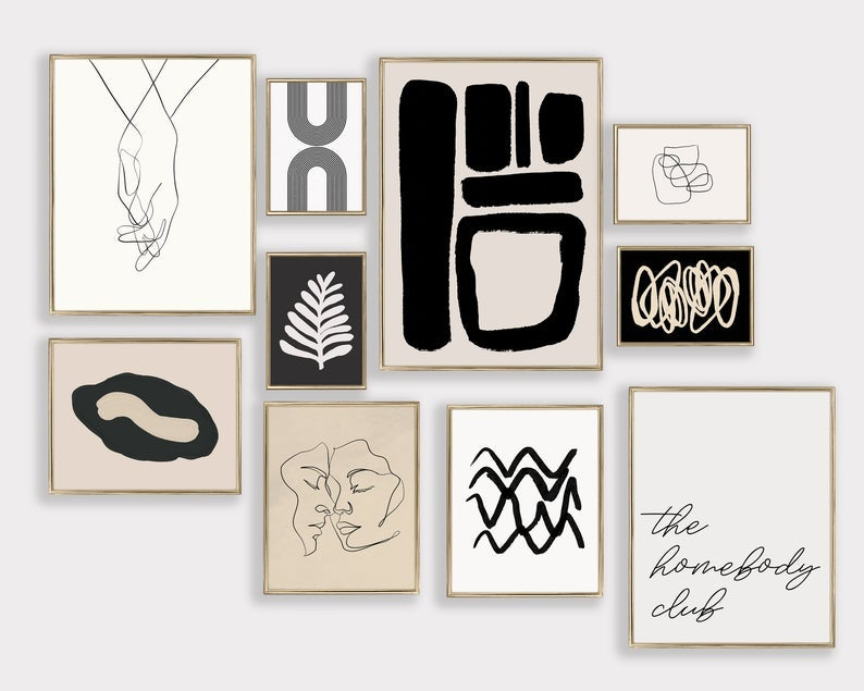 the black, white, and tan prints including abstract art, faces, a sketch of clasped hands, a leaf, and text that reads