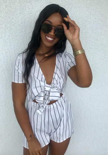 reviewer wearing the striped romper