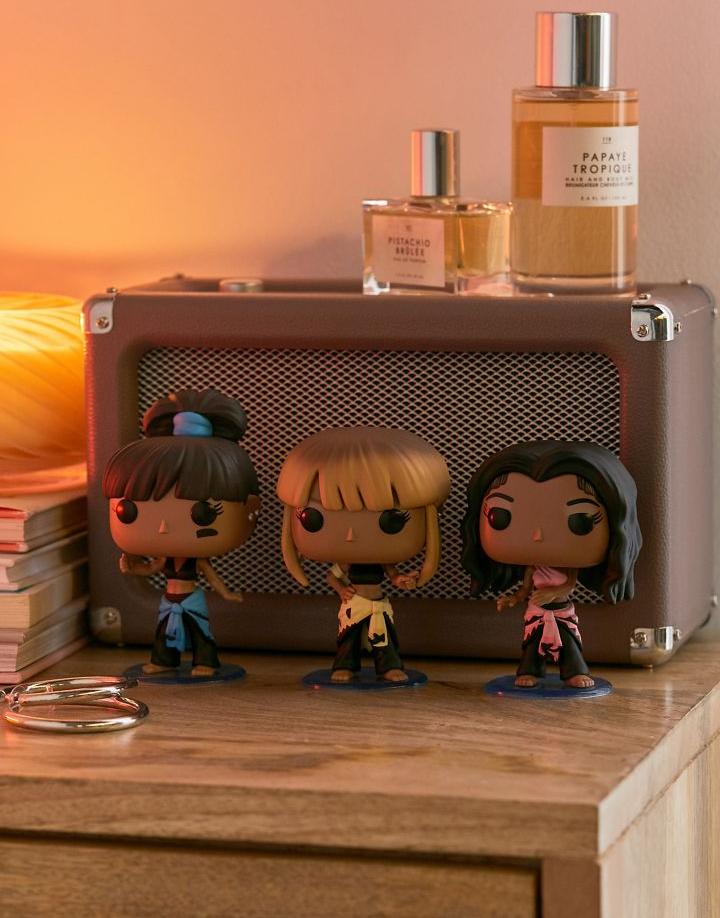 the three TLC Funko Pop figurines on a table