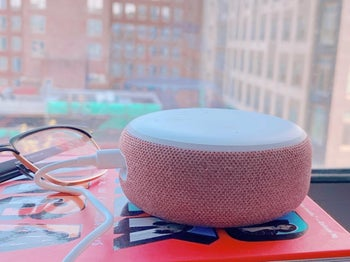 Reviewer photo of the pink Echo sitting on top of a book