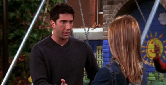 Ross and Rachel are by a swing set about to kiss