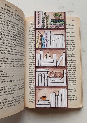 the bookmark with some of the spines filled in with colors and titles