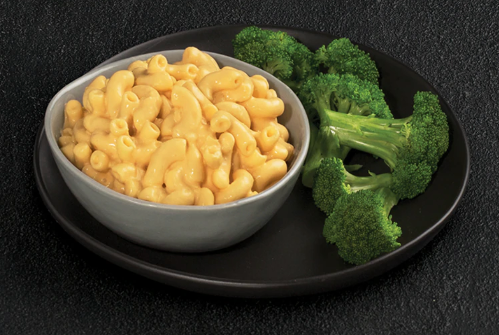 A bowl of mac 'n' cheese with a side of steamed broccoli