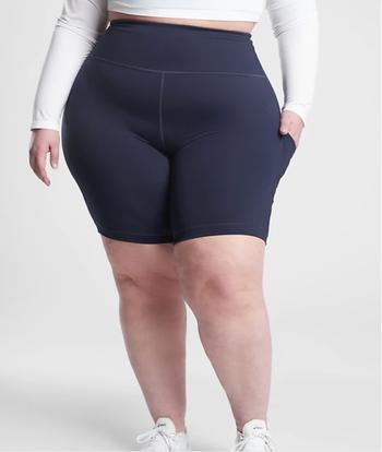 Model in navy blue high waist knee length bike shorts