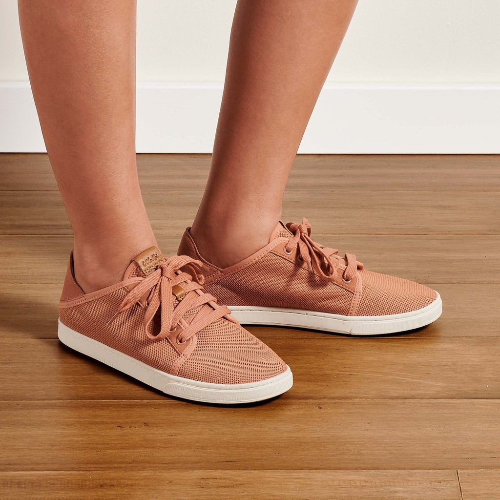 model wearing the mesh sneakers in pink with white sole