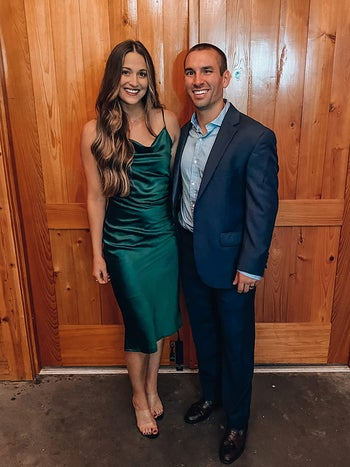 reviewer wearing the emerald green cowl neck midi dress