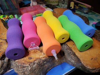 thick foam grippers around pencils in different colors