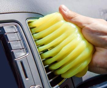 a model using the gel to clean a car air vent