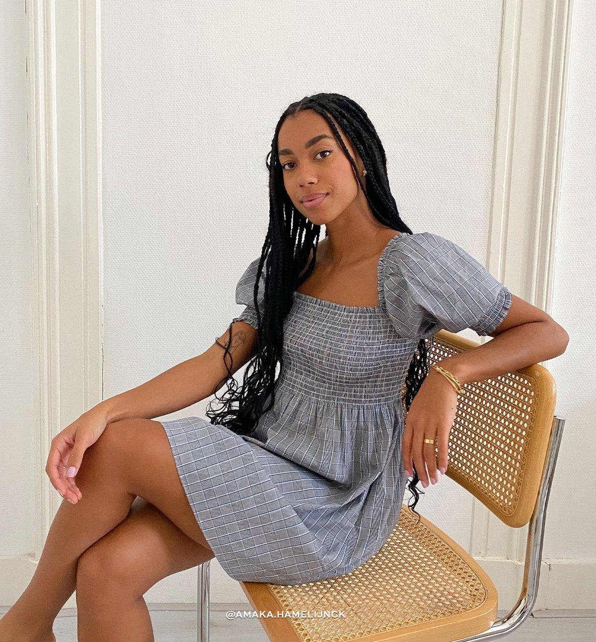 model wearing a mini dress
