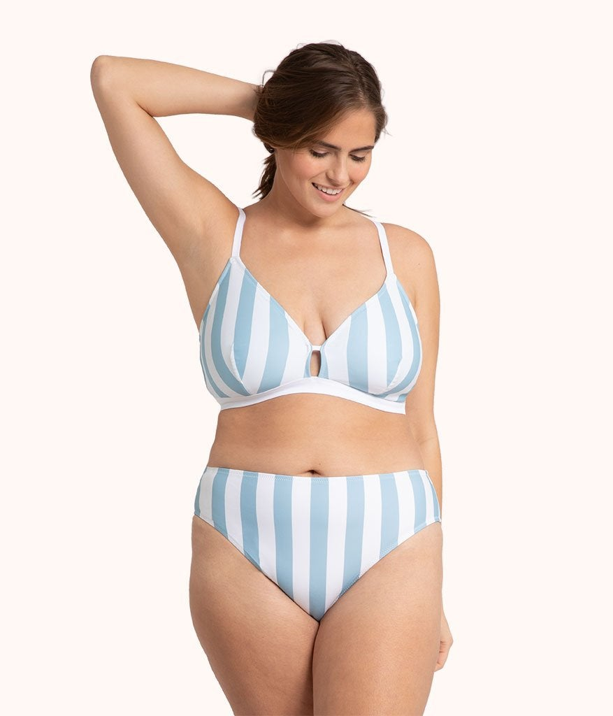 A model in the white and light blue stripe set