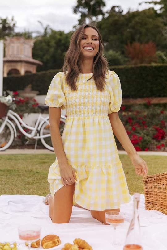 model in yellow and white short sleeve mini dress