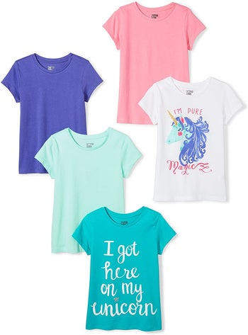 four different kid's t-shirts