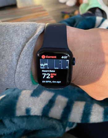 a reviewer photo of someone showing their apple watch to show their heart rate