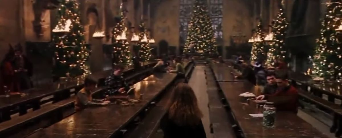 The Great Hall at Hogwarts with Christmas trees all around