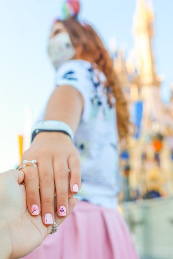 a model with a manicure featuring mickey balloons