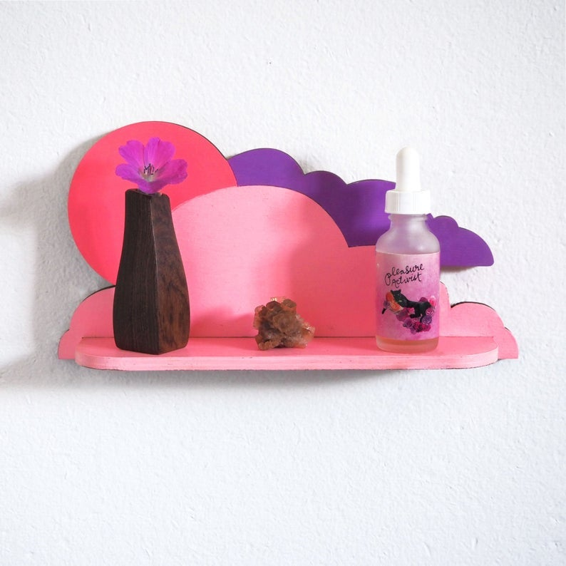 the pink and purple wood shelf shaped like clouds and the sun