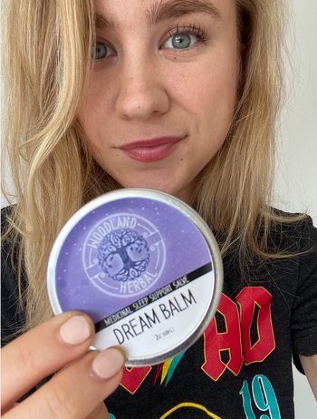 BuzzFeed editor holding purple canister of dream balm