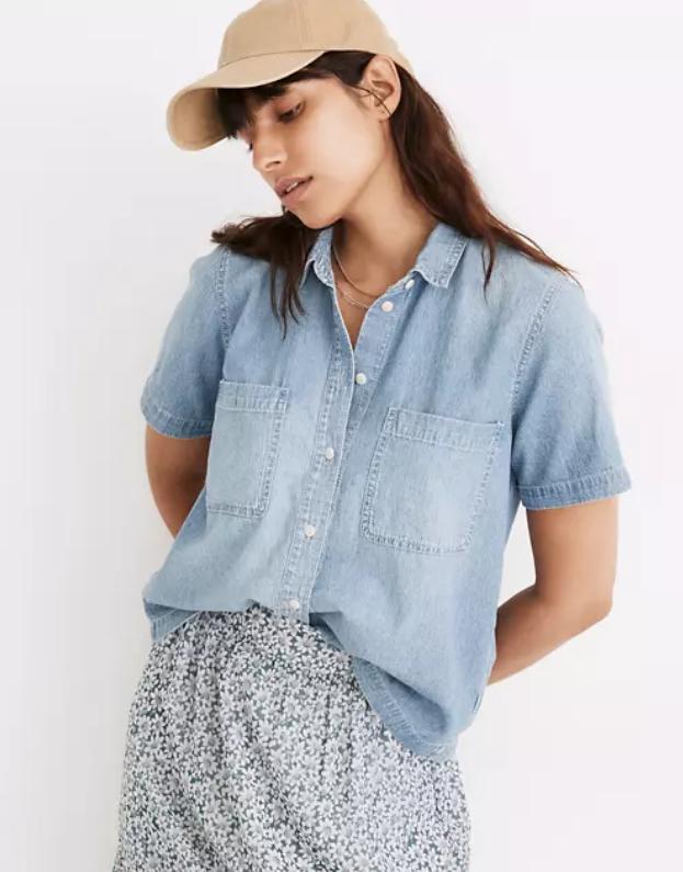 model wearing shirt tucked into skirt