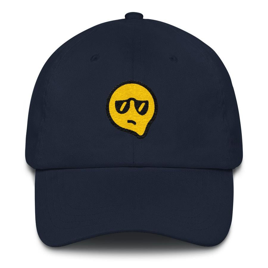 navy cap with melting yellow face wearing sunglasses and a displeased expression