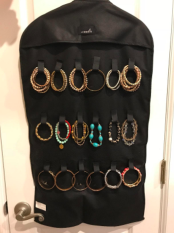 reviewer photo of the opposite side of the organizer with loops for holding necklaces and bracelets without tangling
