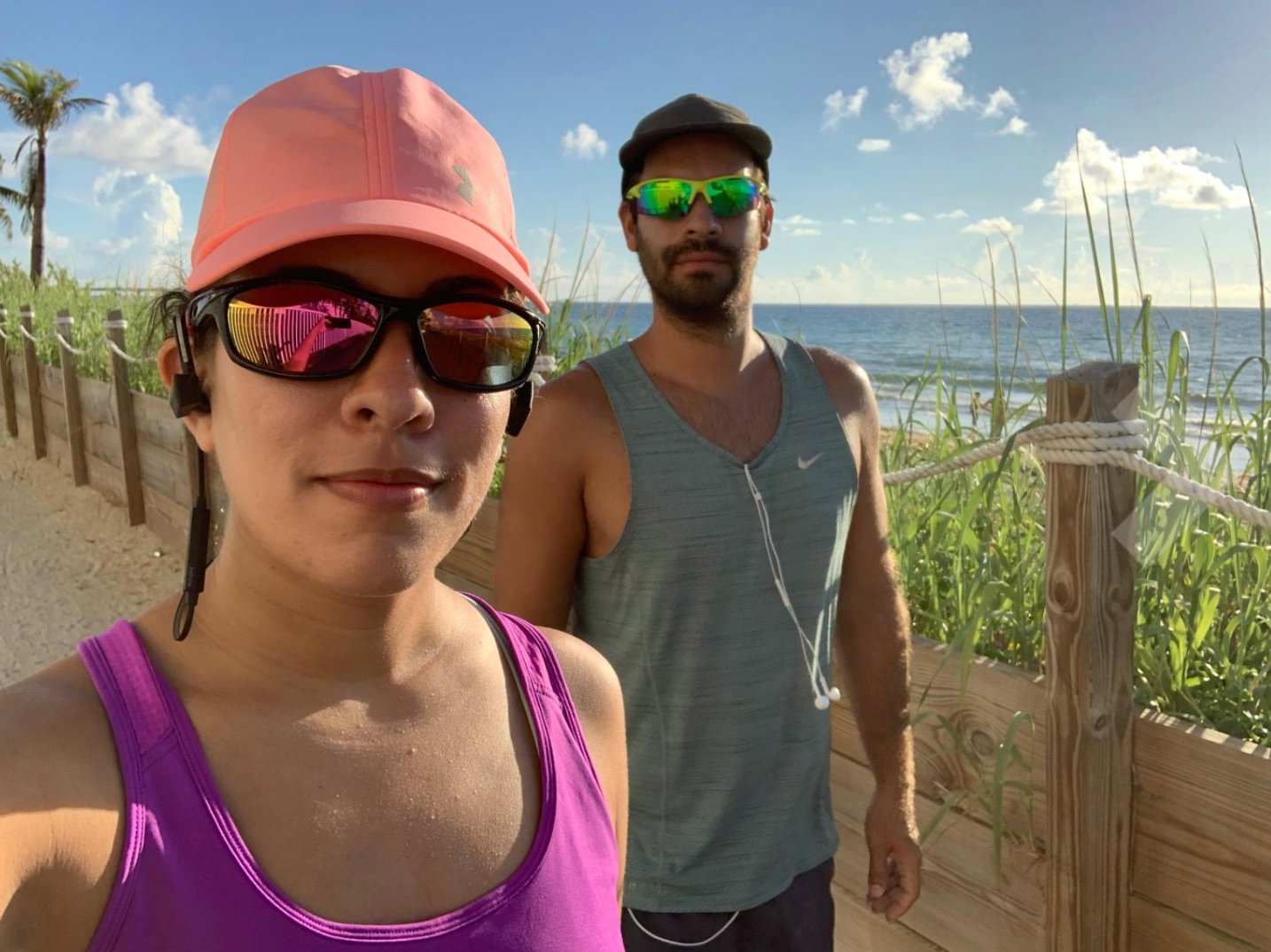 Two reviewers working out in polarized sunglasses, one in a black pair and one in a white pair