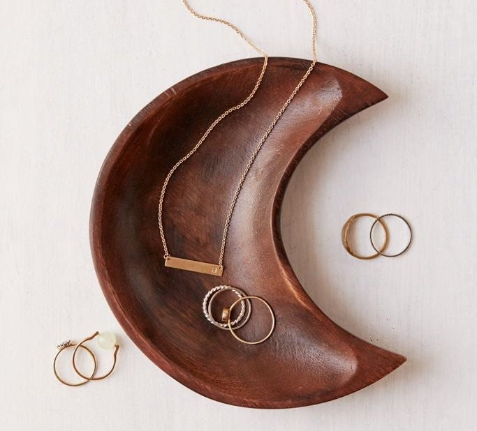 A crescent moon-shaped jewelry bowl