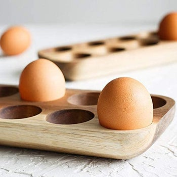 two eggs in the wooden holder