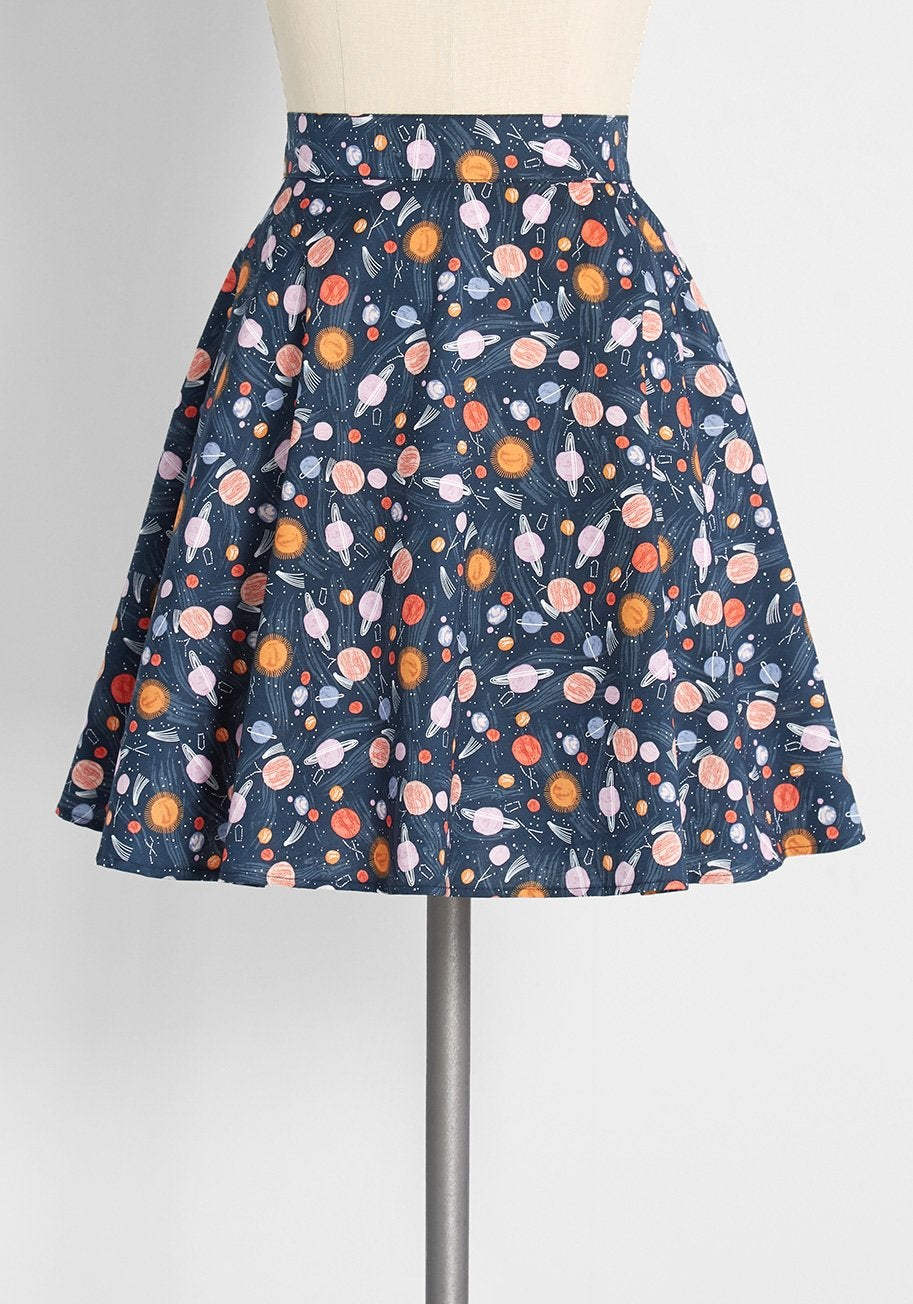 a navy blue skirt with a pattern of planets all over it