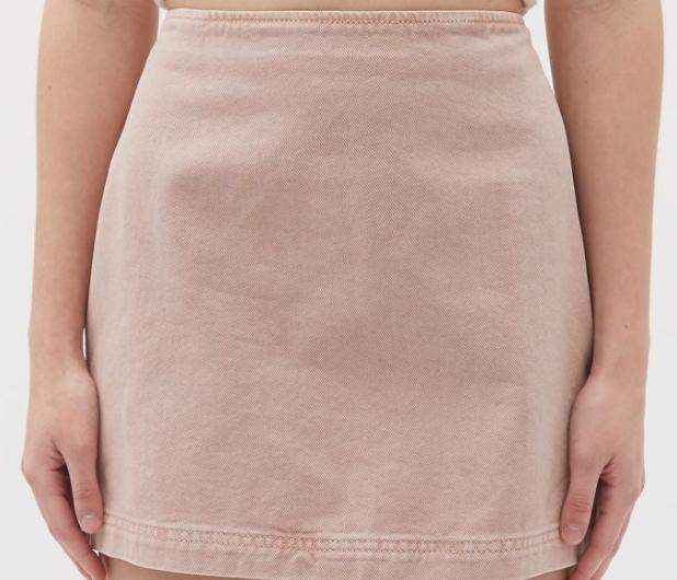 A faded pink denim mini skirt