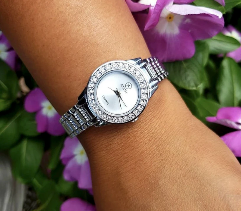the silver watch on a wrist
