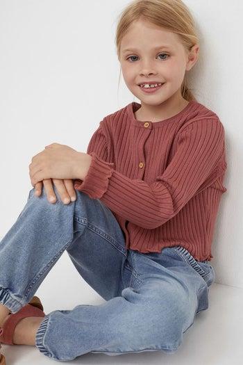 a child model in pull in denim