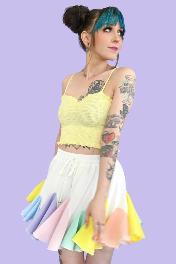 white skirt with circular pleated fabric in different colors sewn in to the bottom