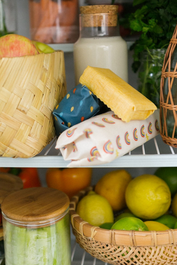 A pantry with three foods wrapped in the colorful wraps