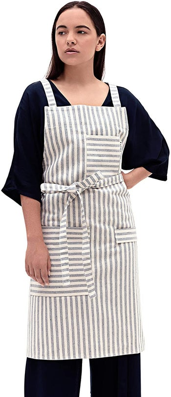 front view of a model wearing the striped apron