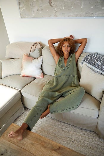 front view of a model wearing the jumpsuit in green