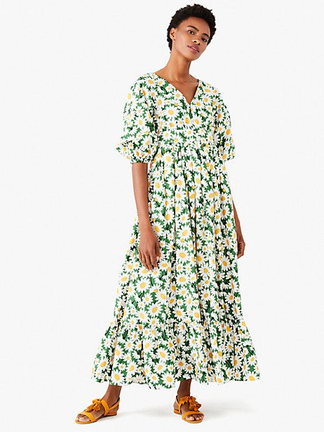 model in green daisy print maxi with elbow sleeves
