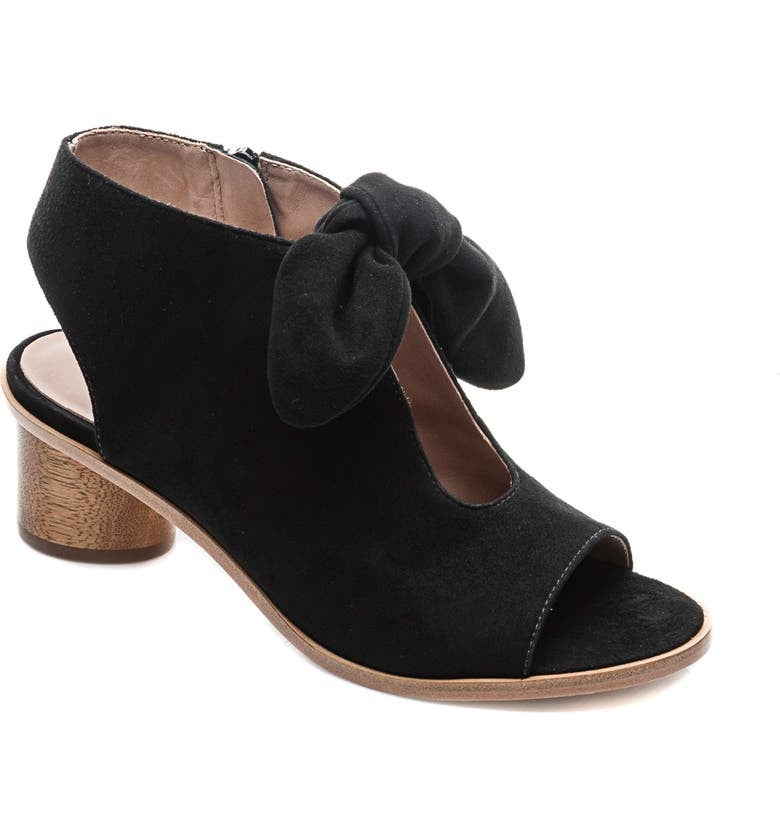 a black peep toe bootie with a bow
