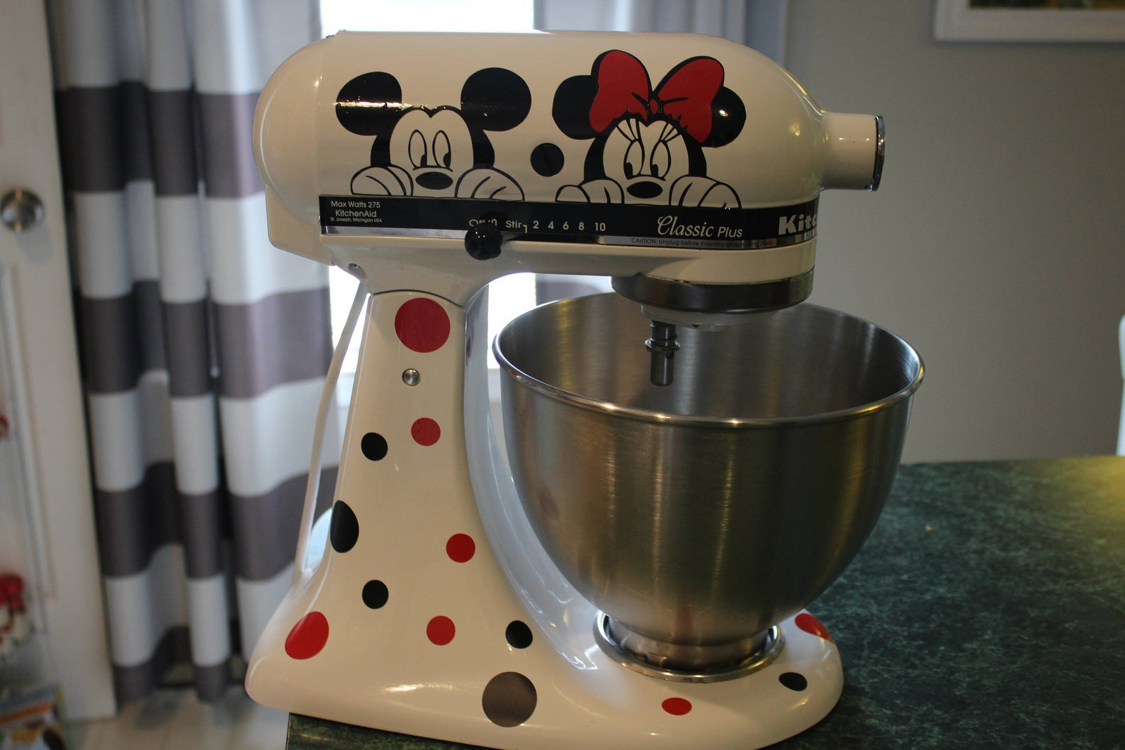 a white mixer with mickey and minnie decals