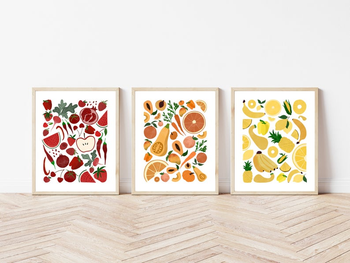 three prints each featuring a medley of vegetables in a different color in red, orange, and yellow