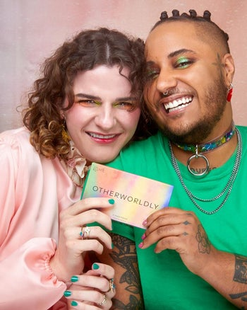 two models holding up the makeup palette