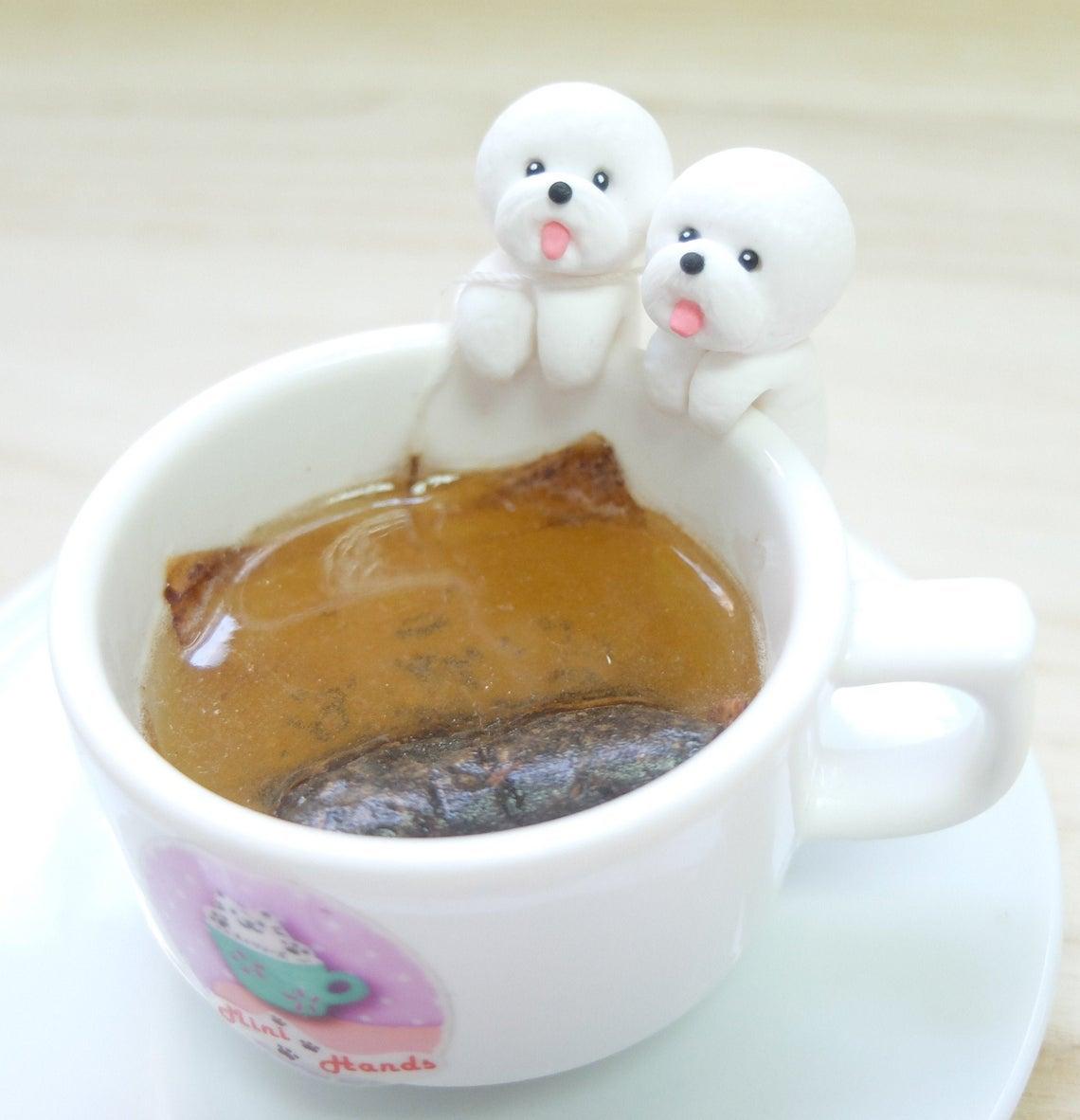 tiny bichons on edge of mug