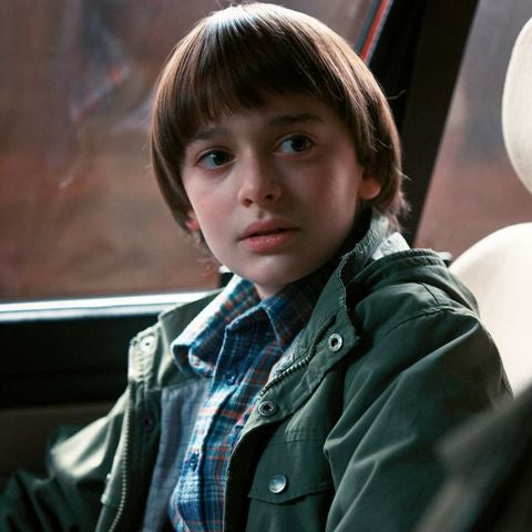 Will is sitting in the passenger's seat of a car, looking worried