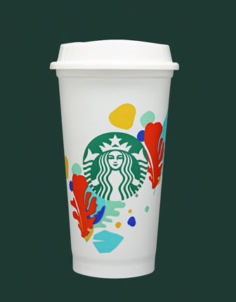 A reusable Starbucks cup with a Starbucks logo on the center surrounded by seaweed-like leaves