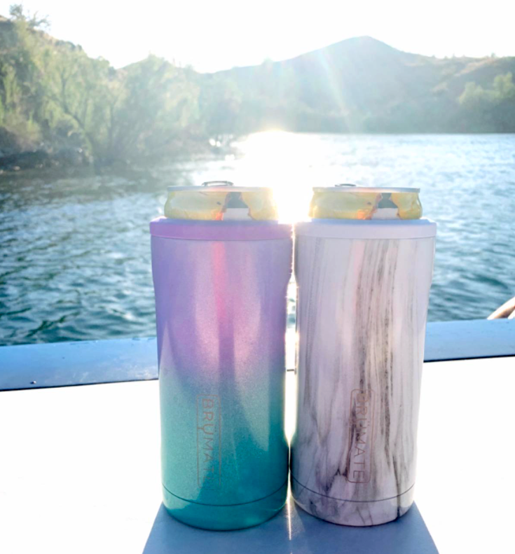 reviewer image of two slim cans in different patterned koozies