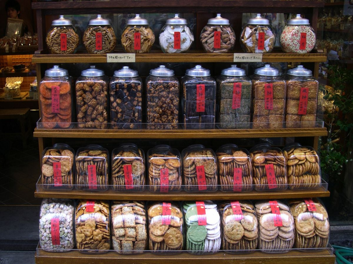 A display of several full jars of different types of cookies