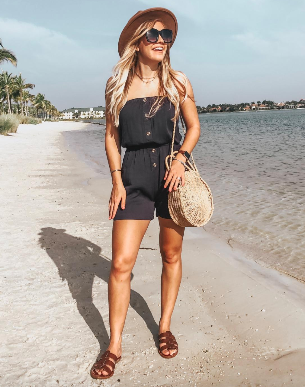 reviewer wearing black strapless romper