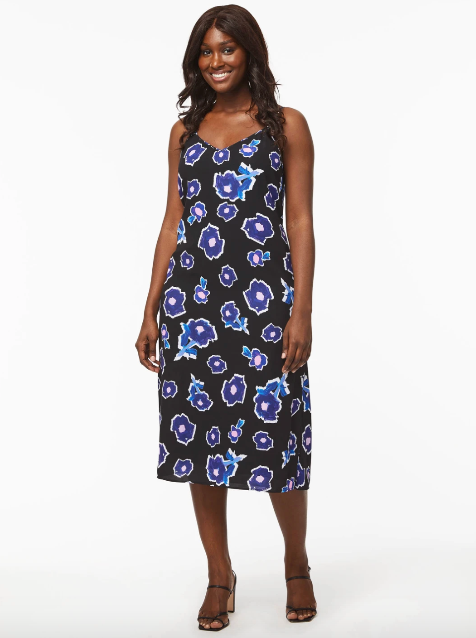 model wearing black dress with blue florals